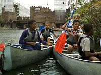 photo of a group canoeing at The Pirate Castle